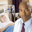 Doctor Looking Serious In Hospital Room,Senior Woman Lying In Ho — Stock Photo