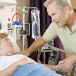 Middle Aged Man Visiting His Mother In Hospital - Stockfoto