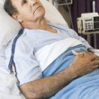 Stock Photo: Middle Aged Man Lying In Hospital Bed