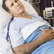 Man Lying In Hospital Bed - Stock Photo