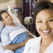 Doctor Smiling In Hospital Room — Stock Photo #4779681