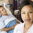Doctor Looking Serious,Standing In Hospital Room — Stock Photo #4779682