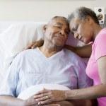 Senior Couple Embracing In Hospital — Stock Photo