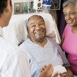 Senior Couple Talking,Smiling With Doctor — Stock Photo