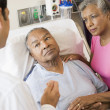 Senior Couple Talking To Doctor,Looking Worried — Stockfoto