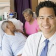 Doctor Looking Cheerful In Hospital Room — Foto de Stock