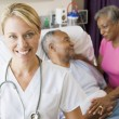 Doctor Looking Cheerful In Hospital Room — Stockfoto