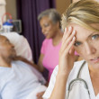 Doctor With Headache In Patients Room — Stock Photo #4779716