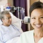 Nurse Standing In Patients Room — Stock Photo