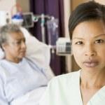 Nurse Standing In Patients Room Looking Serious — Stock Photo