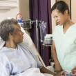 Nurse Talking To Senior Woman - Foto Stock