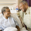 Senior Couple Smiling At Each Other In Hospital — Stock fotografie