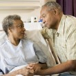 Senior Couple Standing In Hospital Together - ストック写真