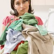 Woman Holding Pile Of Laundry — Foto Stock