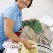 Stock Photo: WomLoading Washing Machine