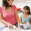 Mother And Daughter Ironing — Stock Photo #4779815