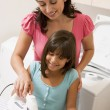 Foto Stock: Mother And Daughter Ironing