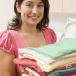 Woman Holding Fresh Laundry — Stock Photo #4779829