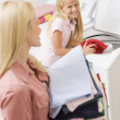 Mother And Daughter Doing Laundry — Stock Photo #4779862