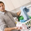 Man Doing Laundry - Stock Photo