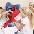 Royalty-Free Stock Photo: Siblings Fighting While Doing Laundry