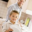 Father And Son Cleaning Dishes — Stock Photo #4779896