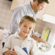 Father And Son Cleaning Dishes — Stock Photo #4779897