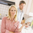 Stock Photo: Husband And Wife Doing Dishes