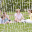 Stock Photo: Five young friends on soccer field talking and smiling
