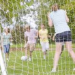 Five young friends playing soccer — Stock Photo