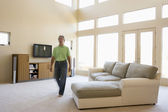Man walking through living room — Stock Photo