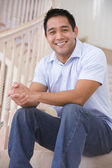 Man sitting on staircase smiling — Stock Photo