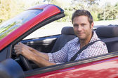 Man in convertible car smiling — Foto de Stock