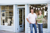 Couple standing in front of organic food store smiling — Stok fotoğraf