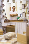 Man in birdhouse store smiling — Stock Photo