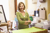 Woman in store smiling — Stock Photo