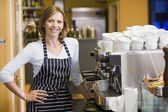 Woman making coffee in restaurant smiling — Stockfoto