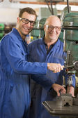Two machinists working on machine — Stock Photo
