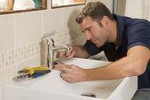 Plumber working on sink — Stock Photo