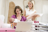 Two women and a baby in home office with laptop — Stock Photo