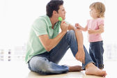Father and daughter indoors playing — Stock Photo