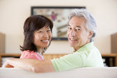 Couple watching television smiling — Stock Photo