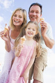 Family standing outdoors with ice cream smiling — Stok fotoğraf