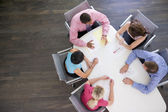 Five businesspeople at boardroom table — Stok fotoğraf