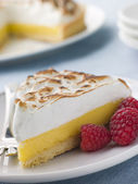 Slice Of Lemon Meringue Pie With Raspberries — Stock Photo