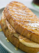 Peanut Butter And Banana Eggy Bread Sandwich With Syrup — Stock Photo