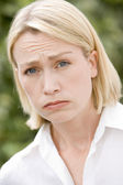 Head shot of sad woman — Stock Photo