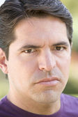Head shot of man scowling — Stock Photo