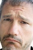 Head shot of sad man — Stock Photo