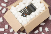 A Package Containing A Calculator — Stock Photo